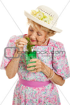 Tipsy Senior Lady Drinking Cocktail