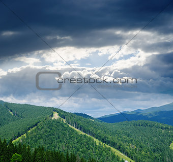 Beautiful green mountain landscape under dramatic sky in Carpath
