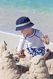 little kid at the beach