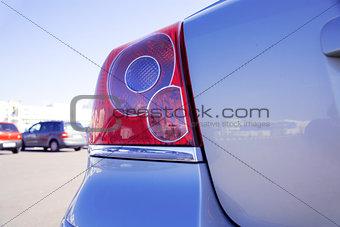 brake lights of modern blue metallic car