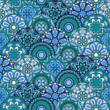 Seamless pattern with blue circles and floral elements
