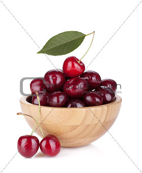 Ripe cherries in a wooden bowl