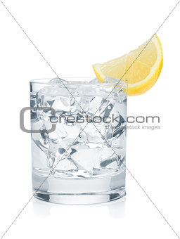 Glass of pure water with ice cubes and lemon slice