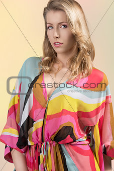 portrait of blonde girl with colorful dress