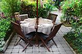 Outdoor cafe in a green garden