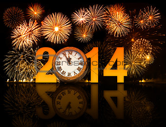 2014 year with fireworks and clock displaying 5 minutes before m