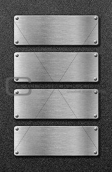 four stainless steel metal plates