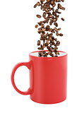 red coffee cup isolated with falling coffee beans