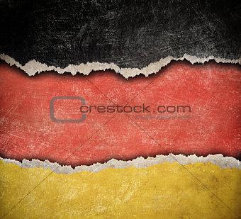 Grunge ripped paper German flag pattern