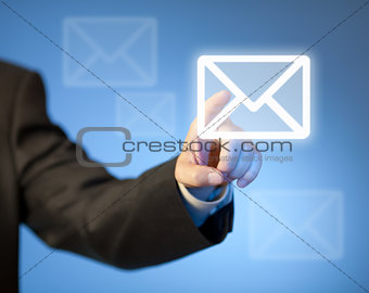 Hand pressing virtual mail button