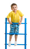Happy kid boy on top of gymnastics ladder