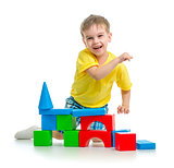 happy kid playing with colorful blocks isolated