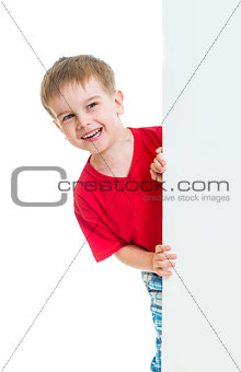 kid boy behind blank advertising banner