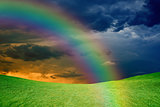 Rainbow over green hills