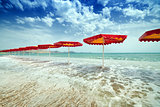 Red umbrellas on beach