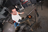 Artisan Handling Hot Glass