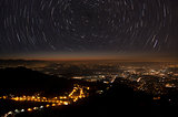 stars trails and city of Varese