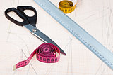 dress pattern at graph paper and fitter instruments