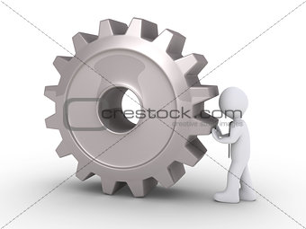 Businessman pushing cogwheel