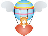 Teddy bear in a hot air balloon with angel wings