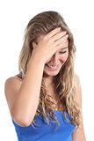 Happy teenager girl laughing with a hand in forehead