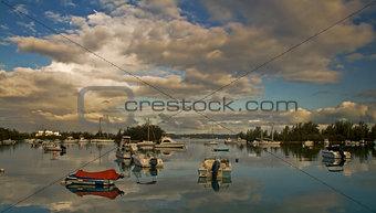 Boats Reflecting on a Calm Sea