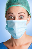 Surprised Female Surgeon with face mask