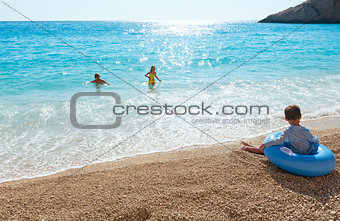 Family on summer Ionian sea