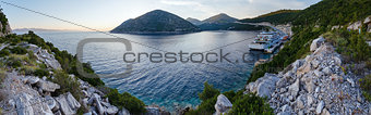 Evening summer coastline with cargo ship  (Ston, Croatia) and fa