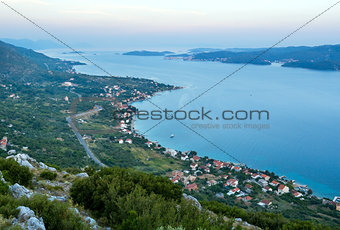 Sea sunset and village  on seashore (Pelješac  peninsula, Croat