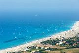 Sea coast and kiteboarders