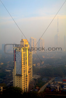 Elevated view of smog filled Bombay Skyline