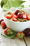 grain muesli with strawberries and cherries - a healthy breakfast