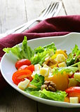 snack salad with cheese and walnuts