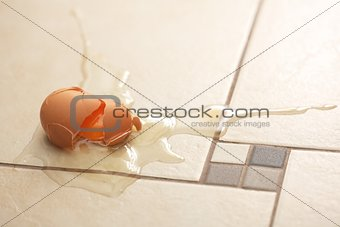 Broken egg on the floor