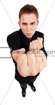 Agressive young man showing fist