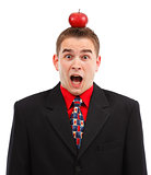 Scared business man with apple on head