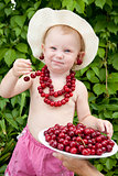 girl with red cherry beads and earrings