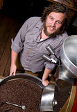 Master Roaster Waits for Coffee Beans to Cool