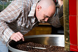 Master Roaster Smells Coffee Beans While Cooling