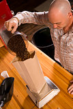 Roaster Owner Does Work of Coffee Packing Bagging