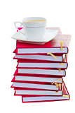 pile of books with cup of coffee