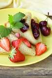 dessert crepes with berries cherries and strawberries