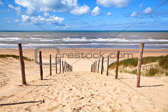 path to sandy beach by North sea