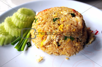 Rice with fried egg and cucumber