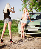 Girls shooting near a car