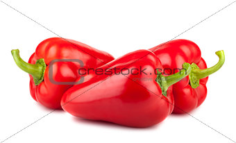 Three ripe red sweet peppers