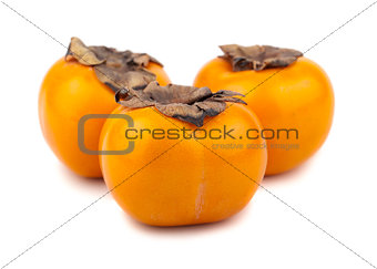 Three persimmon fruits