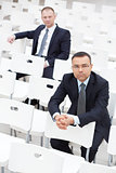 Businessmen in conference hall