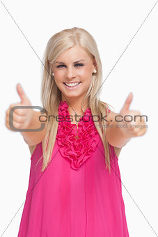 Smiling blonde thumbs-up